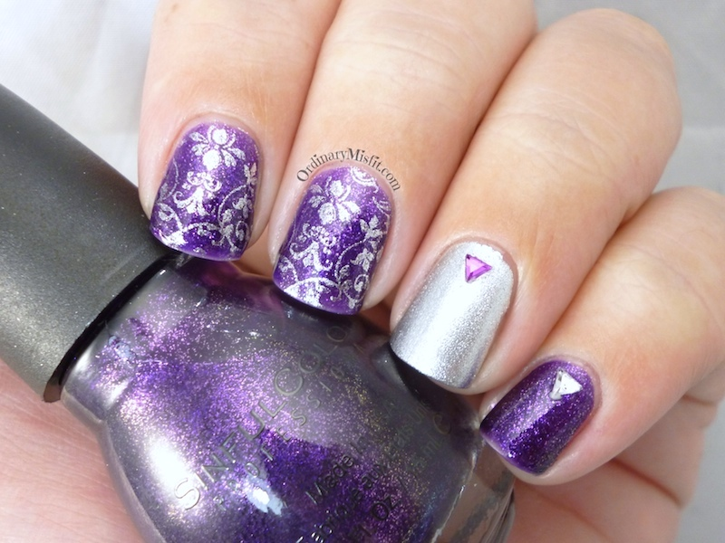 Purple glitter and silver nail art