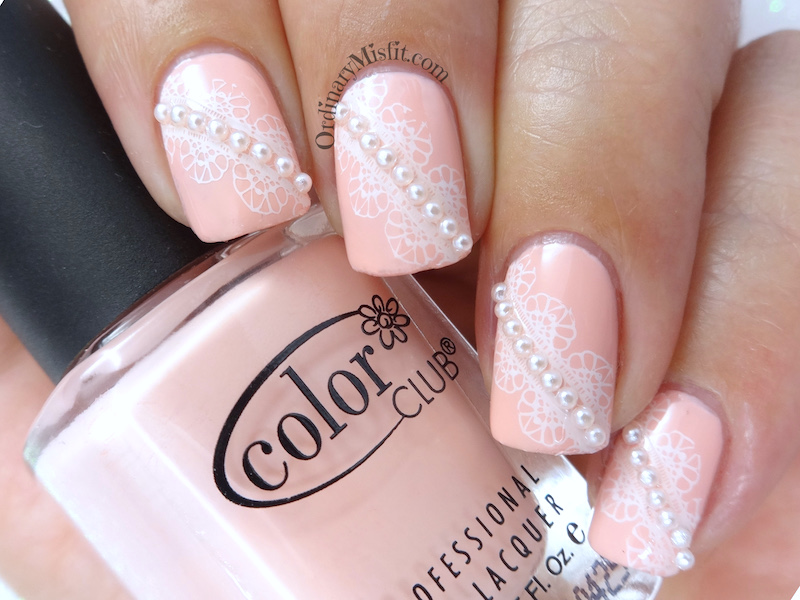 Pearls and lace nail art