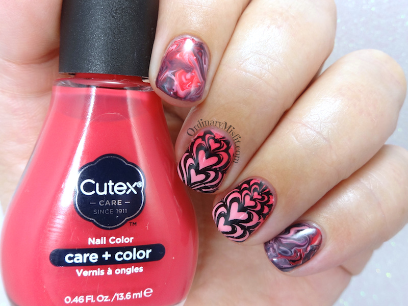 Marbled hearts nail art