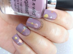 Minimalist metallic nail art