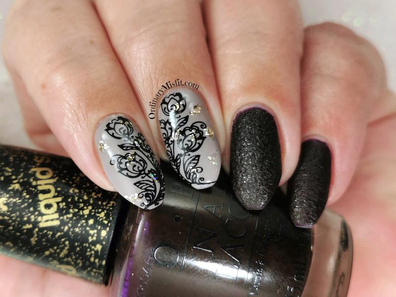 Gold fleck flower nail art